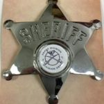 Sheriffs Badge with the Depot Logo / Badge des shérifs avec le logo du dépôt